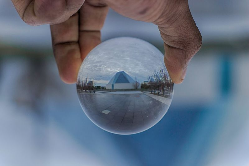 View through crystal ball View Through Crstal Ball View Through Glass Glass - Material Ball Summer Building Architecture Arts Culture And Entertainment Close-up Crstalball Reflection One Person Real People Focus On Foreground Holding Close-up Day Sky Water Outdoors First Eyeem Photo