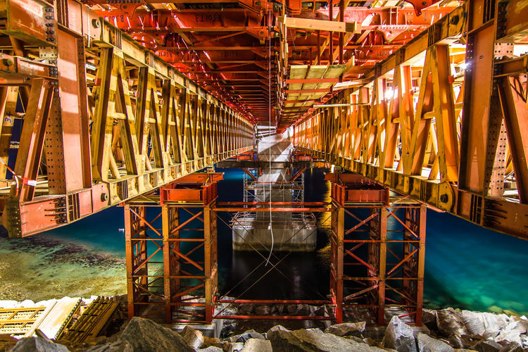 Abundance Bridge - Man Made Structure Building Built Structure Construction Construction Work Engineering Formwork Industry Metallic New Build No Reflection Red Scaffold Scaffolding SUPPORT Symmetry Water