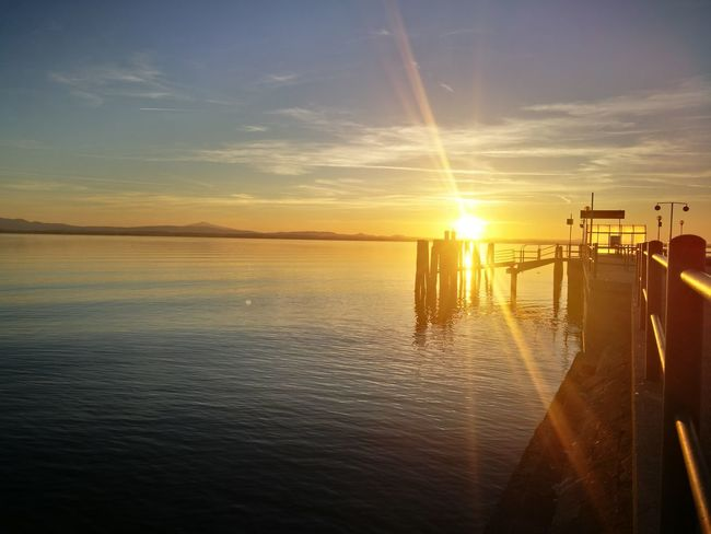 Lake Lake View Lakeside Sunlight Sunset Quiet Places Quiet Moments Water Sky Sun Silhouette Horizon Over Water Tranquility Outdoors Scenics Beach Nature No People Beauty In Nature Nautical Vessel Day Offshore Platform Oil Pump