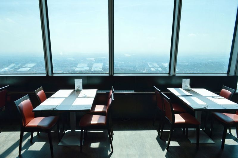 Sunlight Daylight Window Restaurant Cafeteria Style Chair Table City Business Finance And Industry Dining Room Cafeteria Setting The Table Food Service Occupation Cafe Place Setting Dining Table Empty Cafe Culture Absence