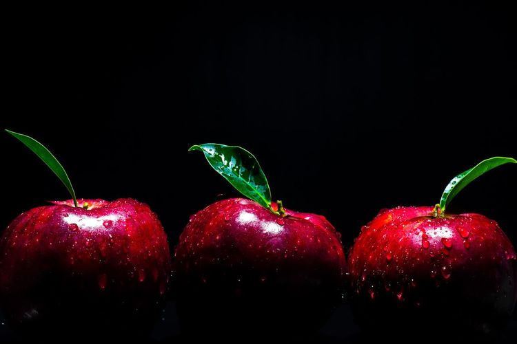 apple on black background Fruit Light Apple Red Healthy Eating Food And Drink Food Fruit Freshness Wellbeing Close-up Black Background Indoors  Still Life Green Color Studio Shot Night Holiday