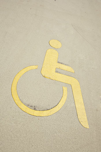 High angle view of disabled sign on street