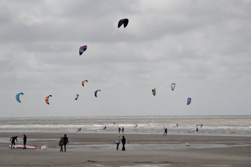 Kitesurfers on the beach at Sankt Peter Ording Beauty In Nature Cloud - Sky Day Flying Horizon Over Water Kite - Toy Kite Surfers Kiteboarding Kitesurfers Large Group Of People Leisure Activity Mid-air Nature Outdoors Parachute People Sand Sea Sky Surfers Travel Destinations Unrecognizable Person Water
