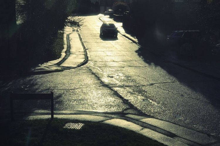Reflected Light Into The Light Road Wet Shadow Sunlight Day High Angle View No People Outdoors Street Sunny