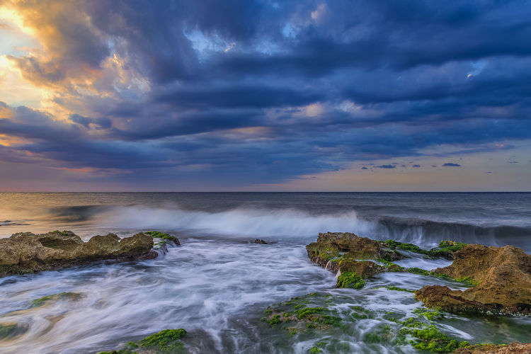 Motion on the coast Beauty In Nature Cloud - Sky Scenics - Nature Water Sky Sea Motion Horizon Over Water Horizon No People Sunset Long Exposure Rock Solid Power In Nature Flowing Water Tranquil Scene Outdoors Non-urban Scene