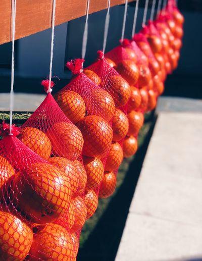 Close-up of oranges hanging for sale at market