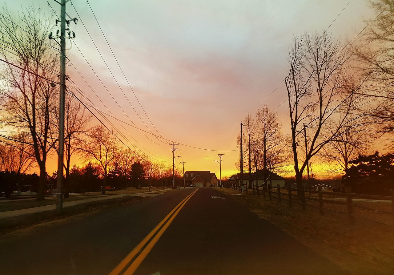 ROAD AGAINST SKY AT SUNSET