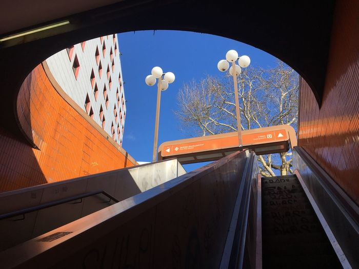 Low angle view of illuminated railroad station against sky