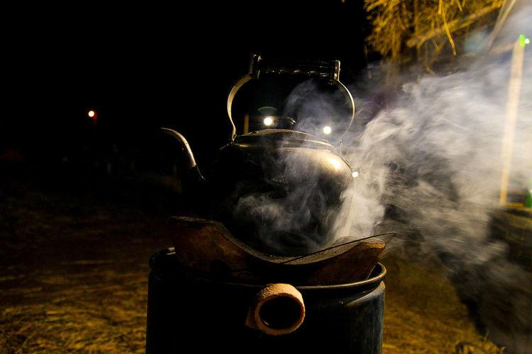 Smoke Emitting From Teapot At Night