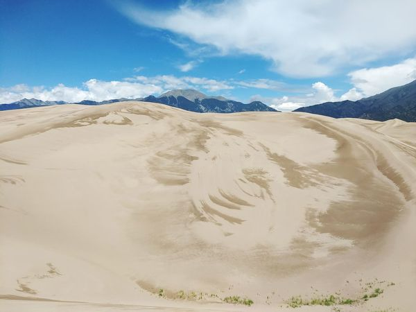 Sand Sand Dune Desert Landscape Cloud - Sky Hill Sky Dramatic Sky Scenics Summer Nature Arid Climate Tranquility Tourism Full Length Outdoors Horizon Over Land Adventure Day Travel Destinations Perspectives On Nature