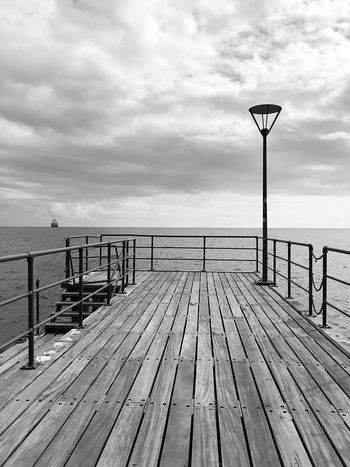 Wooden Relaxation Harmony Lines Shapes Lamp Winter Clouds EyeEm Selects Sky Cloud - Sky Wood - Material Sea Railing Water Pier Tranquility Tranquil Scene Scenics - Nature Beauty In Nature No People Nature Day Beach The Way Forward Horizon Land Street Outdoors