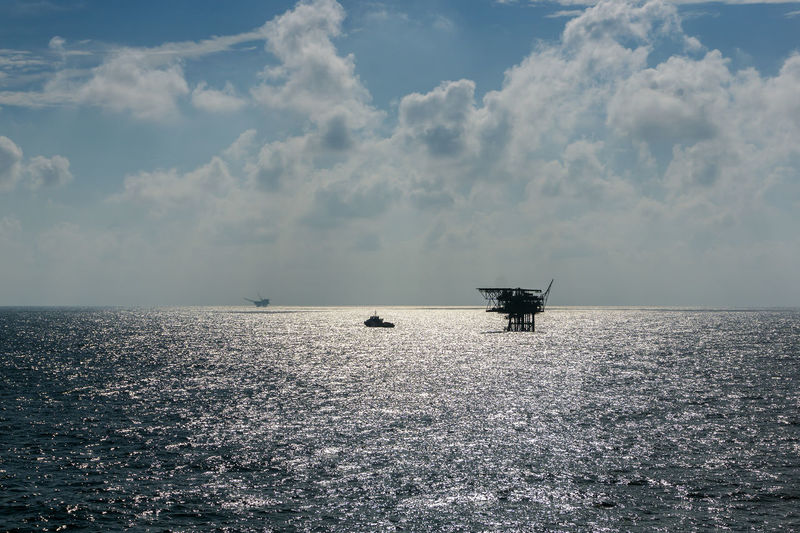oil and gas Silhouette Boat Vessel Morning Environmental Safety Occupation Oil Gas Exploration Upstream Cloudy Petroleum Fossil Fuel Oil And Gas Industry Offshore Offshore Life Platform Production Oil Rig Oil Field Sky Horizon Over Water Wave Sea Seascape Silhouette Ocean