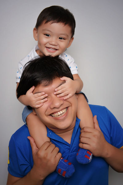Adult Bonding Bonding Time Casual Clothing Cheerful Child Childhood Eyeem Philippines Father Father & Son Father And Son Father's Day Fatherhood  Fatherhood Moments Gray Background Happiness Indoors  People Portrait Smile Smiling Studio Shot Togetherness Toothy Smile Two People The Portraitist - 2017 EyeEm Awards BYOPaper! Be. Ready. This Is Family