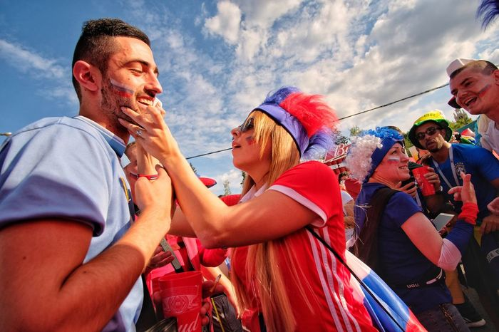 Man from Argentina and women from Russia in FIFA fun zone Happy Funatwork Funzone Fun Football Fifa18 Fifa2018 Fifa Group Of People Men Adult Sky Togetherness Women World Cup 2018 Friendship Low Angle View People Leisure Activity Young Adult Fun Cloud - Sky Couple - Relationship Emotion Happiness Enjoyment Young Men Outdoors The Street Photographer - 2018 EyeEm Awards