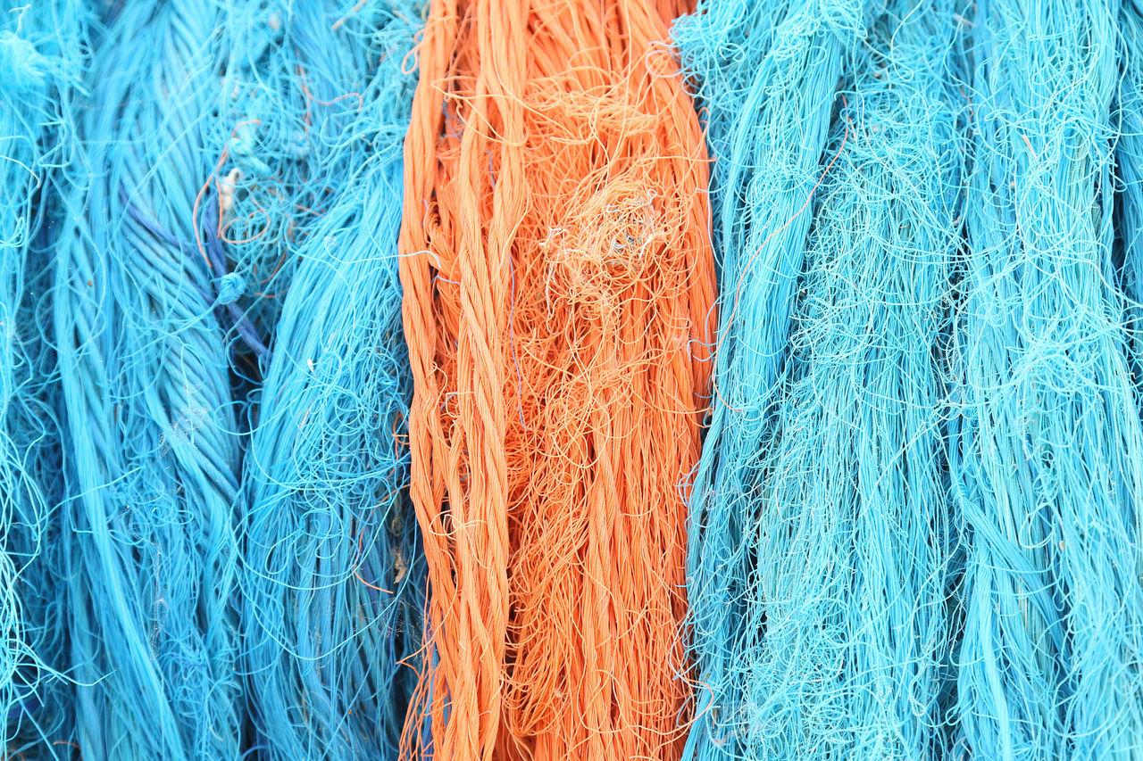 full frame, backgrounds, blue, close-up, no people, textile, fishing net, thread, still life, textured, pattern, tangled, day, high angle view, string, commercial fishing net, fishing industry, rope, rod, fishing, turquoise colored, complexity