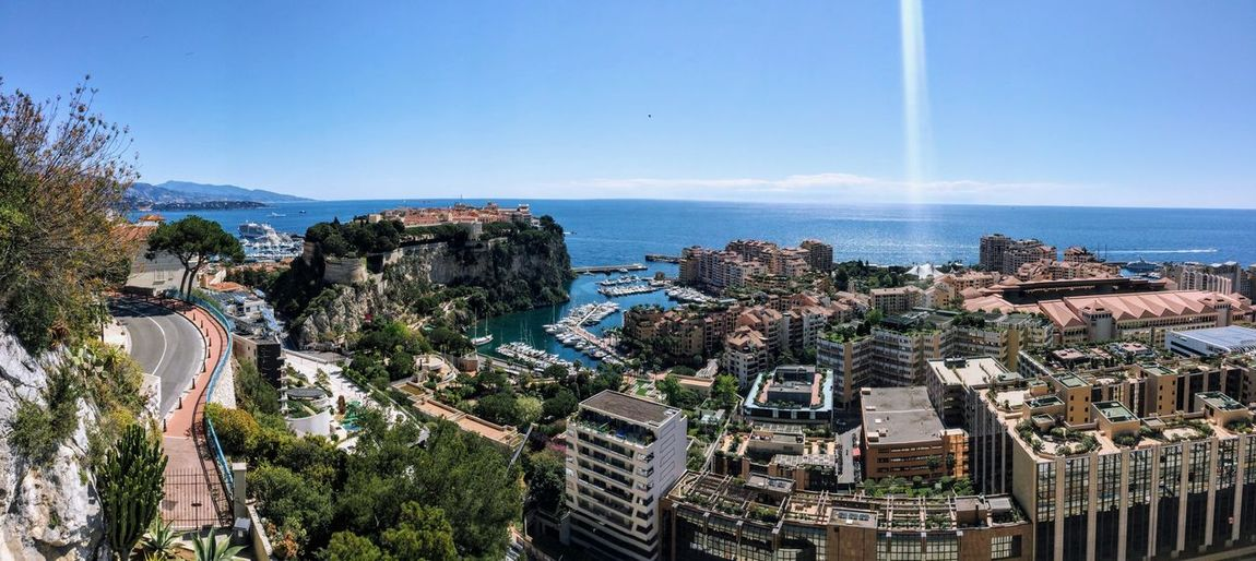 Panoramic view of cityscape against sea