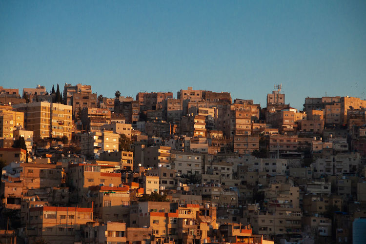 Amman, Jordan Jordan Middle East Jordan Amman Jordan Amman Apartment Sunlight Blue Day Landscape Travel Destinations Outdoors Nature Clear Sky No People Copy Space Cityscape Built Structure Residential District City Sky Building Architecture Building Exterior House