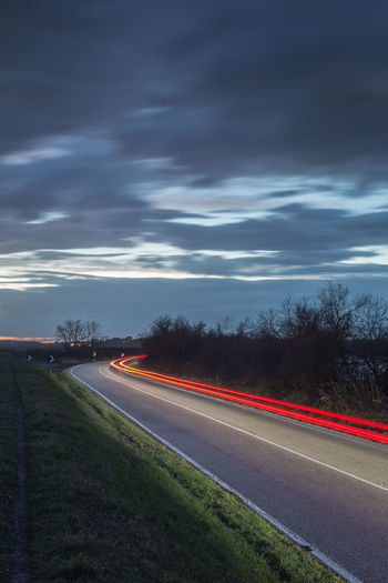Long exposure with auto light trails, in a countryside street of Italy. Automotive Beauty In Nature Car Trails Cloud - Sky Illuminated Light Trail Light Trails Long Exposure Long Exposure Night Photography Long Exposure Shot Motion Nature Night No People Outdoors Road Sky Speed Street Transportation