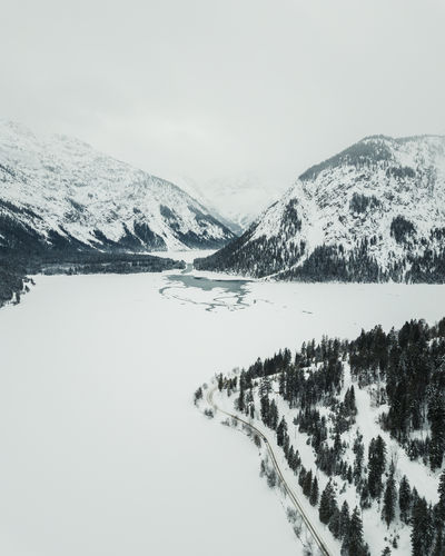 Beautiful Plansee captured during in winter by drone. Cold Temperature Winter Mountain Snow Scenics - Nature Beauty In Nature Tranquil Scene Sky Snowcapped Mountain Environment Tranquility Mountain Range Non-urban Scene Nature Day Plant Tree Covering No People Mountain Peak Plansee Tirol  Austria Winter My Best Photo