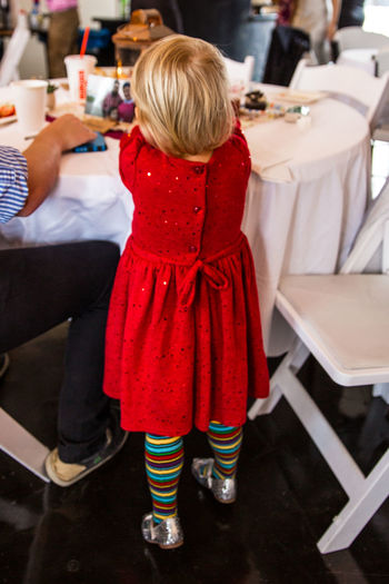 Adult Blond Hair Childhood Children Only Day Full Length Indoors  Little Girl One Person People Real People Rear View Red Silver Shoes Sitting Striped Hose Striped Pattern Striped Sock