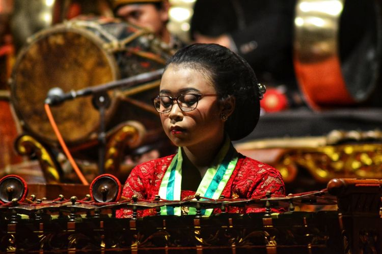 Portrait of a woman playing a traditional musical instrument