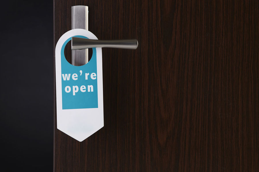 door sign hanging at door handle Copy Space Entrance Holiday Housekeeping Sign Vacations Accessibility Apartment Brown Closed Communication Concept Do Not Disturb Door Door Handle Door Knob Hotel Ideas Knob Lock Permit Privacy Protection Tag We Are Open
