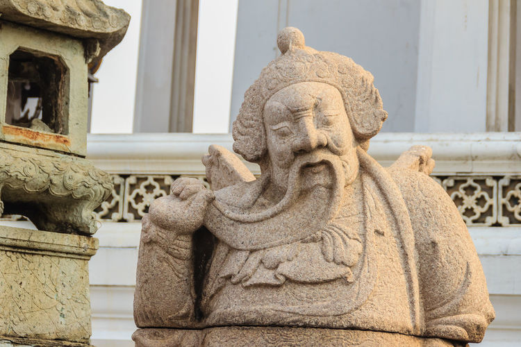 Cute stone of Chinese arts statue in Wat Suthat Temple, Bangkok, Thailand. Chinese Art Chinese God Chinese Doll Wat Suthat Wat Suthat Thepwararam Architecture Art And Craft Building Building Exterior Built Structure Carving - Craft Product Chinese Art & Design Chinese Art And Craft Chinese Dolls Chinese Wall Chinese Warrior Chinese Warrior Statue Close-up Craft Creativity Day Focus On Foreground Human Representation Male Likeness No People Ornate Representation Sculpture Statue Stone Material Stone Of Chinese The Past