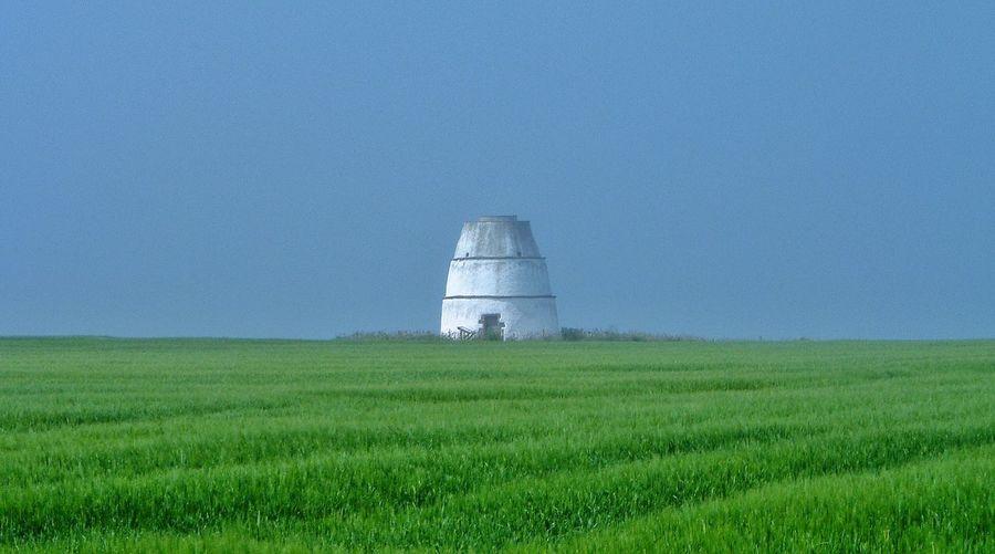 Disused Windmill on the NE Coast of Scotland . Nairn United Kingdom Uk Summer Mist Misty Green Blue Sky