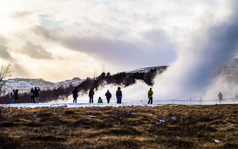 Tourists watching the geyser strokkur erupt