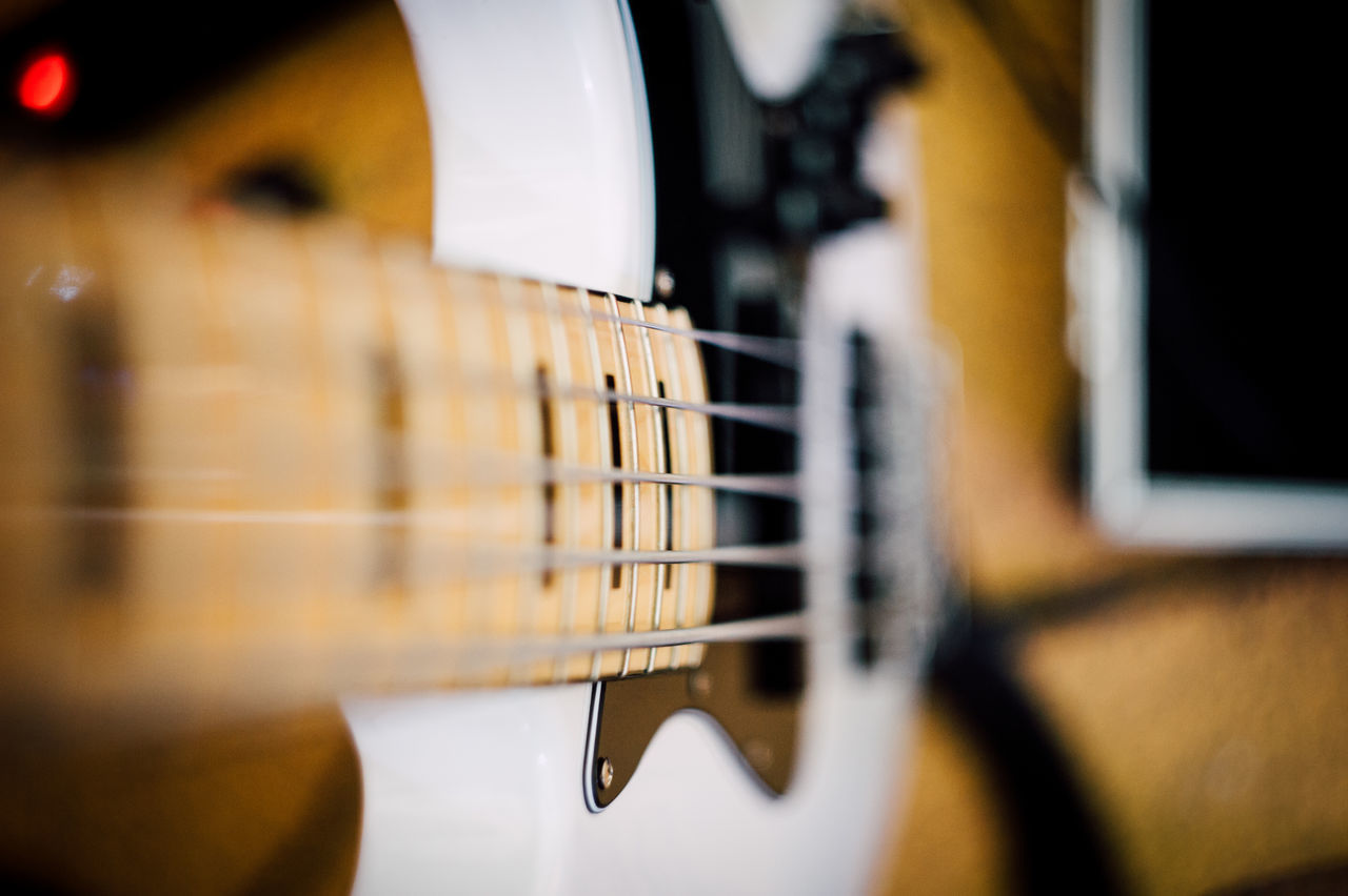 music, musical instrument, guitar, selective focus, musical instrument string, musical equipment, arts culture and entertainment, acoustic guitar, indoors, fretboard, close-up, woodwind instrument, no people, string instrument, day