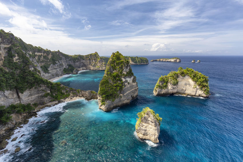 Small islands off of Nusa Penida known as Raja Lima or the five kings in Indonesia. ASIA Atuh Beach Bali Diving Hindu INDONESIA Indonesian Nusa Batupadasan Shrine Tourist Travel Ampoak Atuh Balinese Beach Destination Klungkung Landscape Lebah Nusa Batumategan Nusa Penida Pejukutan Raja Lima Tourism Tropical