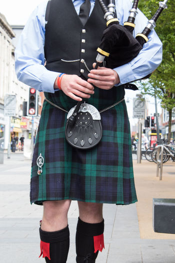 The detail of the bagpiper Adult Bagpipe Bagpipes Day Human Hand Incidental People Kilt Low Section Men Midsection One Person Outdoors People Place Of Heart Real People Scotland Scotland 💕 Scott Scottish Standing Suit Suitedman Tartan The Street Photographer - 2017 EyeEm Awards Well-dressed
