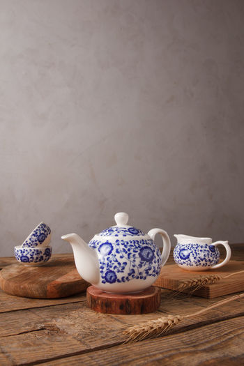 High angle view of tea on table against wall