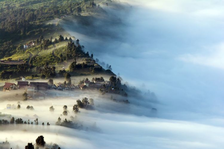 Aerial view of mountains during foggy weather