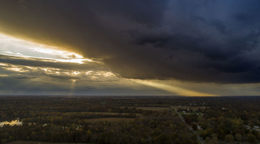 The sun sets over rural Williamson County with colorful clouds and sun rays. Cloud - Sky Sky Environment Scenics - Nature Beauty In Nature Landscape Storm Nature No People Tranquil Scene Dramatic Sky Overcast Sunset Tranquility Horizon Storm Cloud Horizon Over Land Outdoors Cloudscape Ominous Aerial View Aerial Photography Drone  Drone Photography Illinois