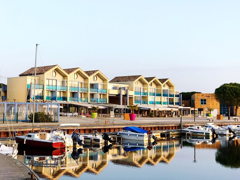 Marina reflected Nautical Vessel Water Moored Building Exterior Clear Sky Mode Of Transport Boat Transportation Built Structure Architecture Outdoors Waterfront No People Day Sky Reflection Leisure Activity Architecture Minimalism Minimalist Personal Perspective