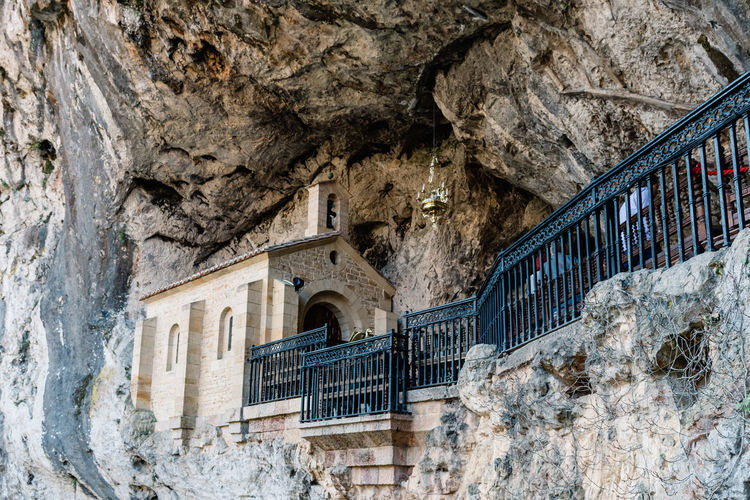 Holy Cave of Covadonga in Asturias Santina Holy Cave Covadonga Architecture Built Structure Building Exterior Building No People Day Arch Solid Window Low Angle View History Rock Rock - Object The Past Nature Outdoors Stone Wall Staircase Wall - Building Feature Wall Church Mary Virgin Mary Asturias
