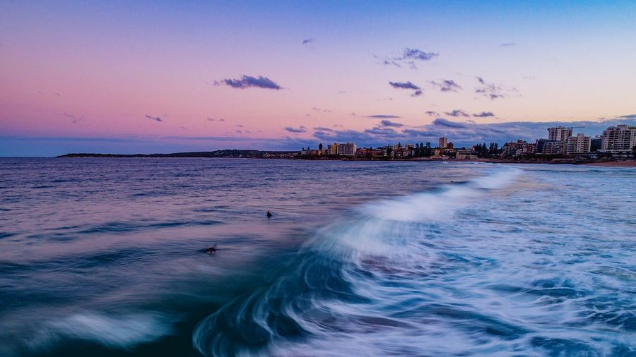 Ocean Motion Cronulla Sea Water Sky Beauty In Nature Motion Beach Scenics - Nature Sunset Horizon Over Water Aquatic Sport City Land Wave Seascape Idyllic Nature Horizon Architecture Surfing Outdoors