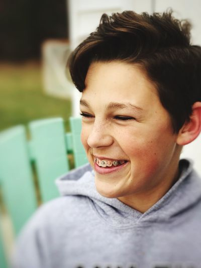 Giddy teenage boy with braces Laughing Grin Grinning Smile Smiling Rosy Cheeks Teenager Teen Goofy Enthusiasm Silly Joyful Happy Cheerful Mood Giddy Braces Real People One Person Smiling Leisure Activity Casual Clothing Focus On Foreground Lifestyles Headshot Happiness Close-up Outdoors Portrait People