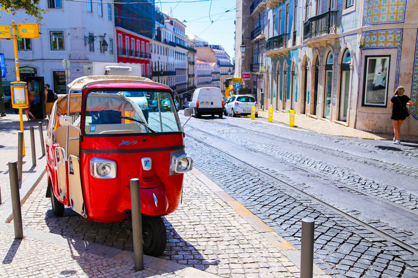 Building Exterior Car City City Life City Street Composition Guidance Incidental People Land Vehicle Life Lisbon Mode Of Transport On The Move Outdoors Perspective Portugal Road Sidewalk Sign Street The Way Forward Traffic Transportation TukTuk Urban