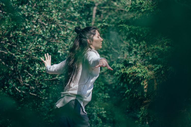 Woman dancing in forest