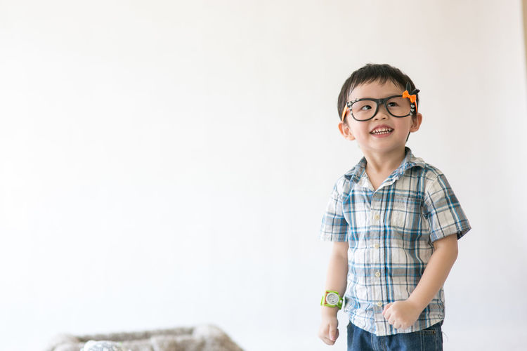 Asia cute little boy Child Portrait Childhood Eyeglasses  Smiling Standing Looking At Camera Happiness Checked Pattern Preschooler Children School Children Back To School