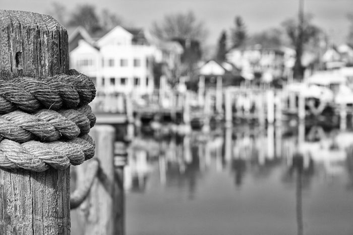 Into The Harbor 2017 Architecture Architecure Black And White Photography Built Structures Close-up Cold Winter ❄⛄ Day Focus On Foreground FreezingMyAssOff Harbor Landmarks Landscape_photography Nature Nautical No People Outdoors Pier Reflection Rope Snowballs Thawing Ice Water Winter Wonderland