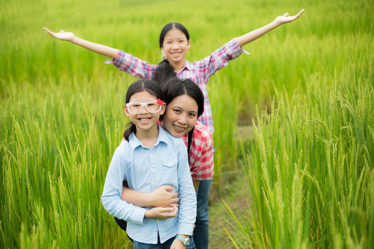 Happiness in rice field Asian  Bonding Cheerful Child Consoling Daughter Family Family With One Child Farm Farmer Females Girls Green Happiness Happy Looking At Camera Mother Nature Outdoors People Portrait Rice Rice Field Smiling Women Women Around The World