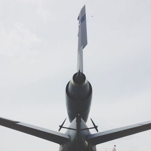 Cropped image of military airplane against sky