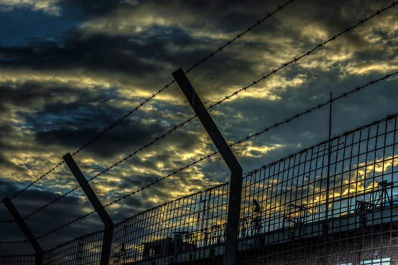Keep out Sunset Building Sky Clouds Fence Barbed Wire Keep Out Eastney Hampshire  England Sunset Razor Wire Barbed Wire Protection Dusk Safety Metal Security Chainlink Fence Fence