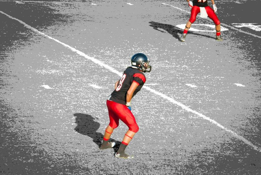 The Color Of Sport Shadow Playing Motion Sport Athlete Football Field Performance Action Action Shot  Sports Stadium Atmosphere Player Athletes Sports Photography High School Sports Football Stadium Team Ball Competitive Sport Sports Clothing Football American Football Uniform Competition