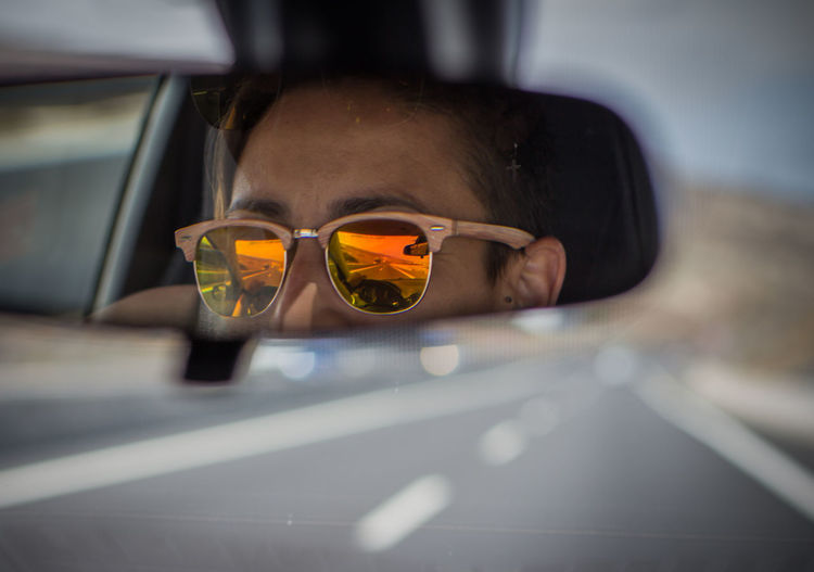 Cars Driver Faces Of EyeEm Mirror Reflection Road Travel Travel Photography Traveling Car Car Interior Face Fashion Glasses Headshot Mode Of Transportation Motor Vehicle One Person Portrait Real People Reflection Roadtrip Sunglasses Transportation Vacation
