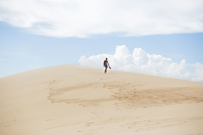 White Sand Dunes, Mui Ne, located in the south of Vietnam. It's about 5-hour away from Ho Chi Minh City. Arid Climate Beach Beauty In Nature Cloud - Sky Desert Full Length Landscape Leisure Activity Lifestyles Muine Muine, Vietnam  Nature Outdoors Sand Sand Dune Scenics Sky Unrecognizable Person Vacations White Sand Dunes Break The Mold TCPM Art Is Everywhere The Great Outdoors - 2017 EyeEm Awards Neighborhood Map Live For The Story Live For The Story Out Of The Box Let's Go. Together. Lost In The Landscape An Eye For Travel Go Higher Inner Power