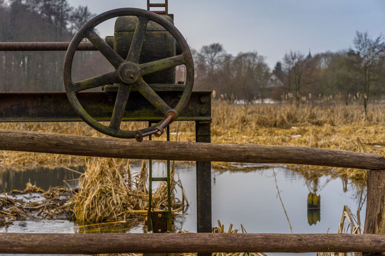 3XSPUnity Beauty In Nature Close-up Day Fence Iron Lake Mill Nature Nature Photography Nature_collection No People Outdoors Reed Reed - Grass Family Reflection Sky Tranquil Scene Tranquility Water Water Wheel Watermill Wood - Material